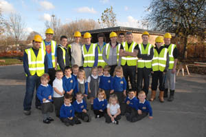 Carpentry students with the children at Bromley Hills Primary School