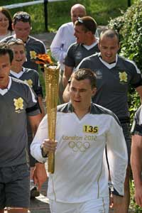 Ross Ensor carrying Olympic Torch