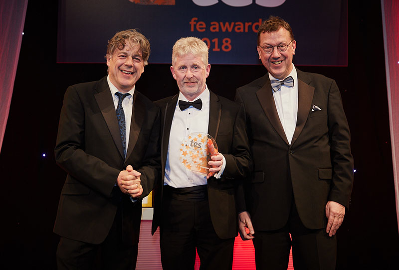 Award host, comedian Alan Davies, Lowell Williams: FE Leader of the Year and Mark White, chair, Stockton Riverside College, and trustee, Education & Training Foundation