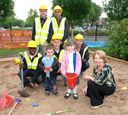 Dudley College bricklaying students with Maggie Hickman Childcare Manager at Bromley Hills and pupils